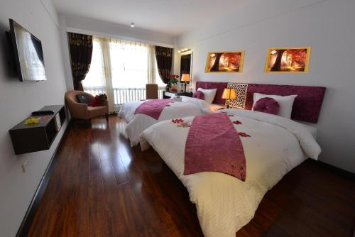 A bed or beds in a room at Golden Sun Suites Hotel