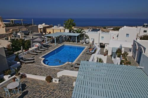 A view of the pool at Aethrio Sunset Village - Oia or nearby