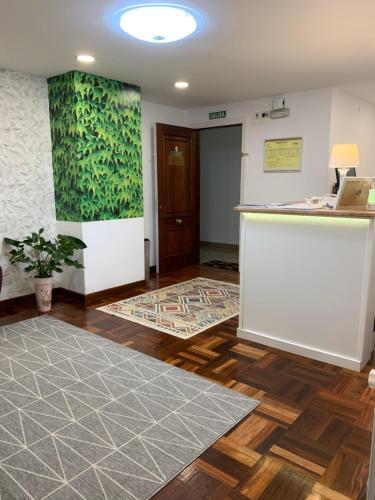 The lobby or reception area at Hostal San Fernando