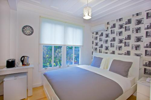 A bed or beds in a room at Dreamers by V&V Cihangir