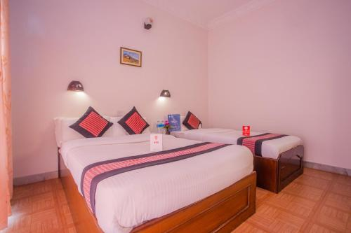 A bed or beds in a room at Hotel Dream Pokhara