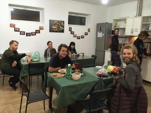 A restaurant or other place to eat at KbH-Karakol based Hostel