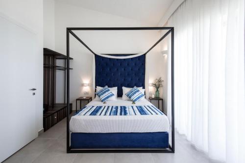 Łóżko lub łóżka w pokoju w obiekcie Aloe Boutique Hotel & Suites - adults only