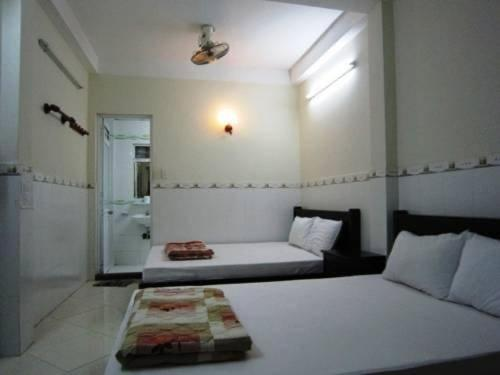 A bed or beds in a room at Thanh Hostel