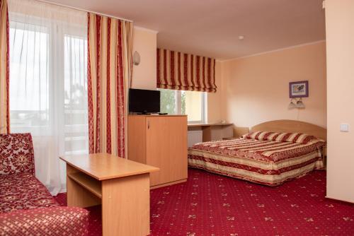 Кровать или кровати в номере Ореанда Бердянск