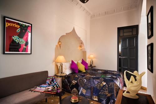 Ein Bett oder Betten in einem Zimmer der Unterkunft Riad Star by Marrakech Riad