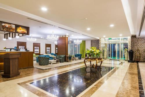 O saguão ou recepção de Le Park Concord Hotel - ARAR