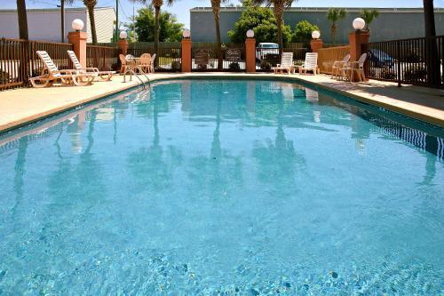 The swimming pool at or near Holiday Inn Express - Biloxi - Beach Blvd, an IHG Hotel
