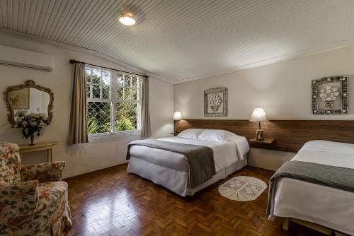 Кровать или кровати в номере Pousada Famiglia Bartho