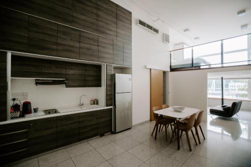 A kitchen or kitchenette at Cayden Riverfront Residences