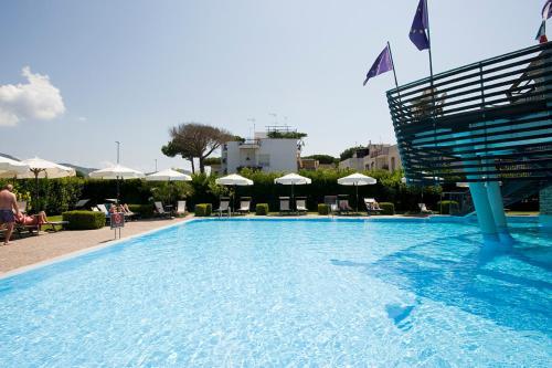 The swimming pool at or near Hotel Poseidon