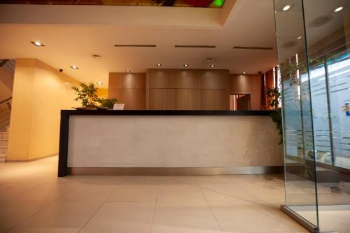 Лобби или стойка регистрации в Lacoba Hotel