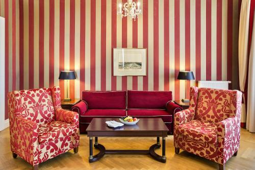 Een zitgedeelte bij Austria Trend Parkhotel Schönbrunn Wien