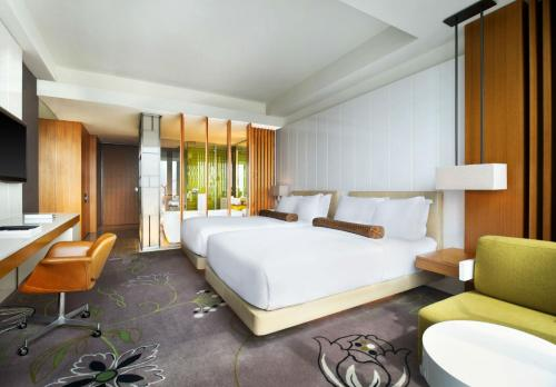 A bed or beds in a room at W Taipei