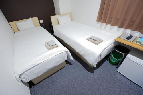 A bed or beds in a room at Hotel Links Dobutsuenmae