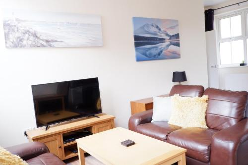 A television and/or entertainment center at Apartment 7 Burnett Court 2 Bed