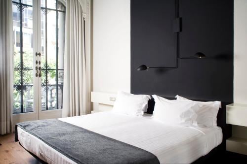 Cama o camas de una habitación en Praktik Rambla