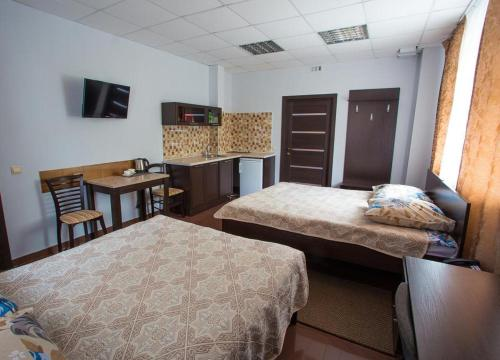 A bed or beds in a room at Hotel Baikal