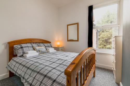 A bed or beds in a room at PLATFORM Fishing Quarter Apartment 2