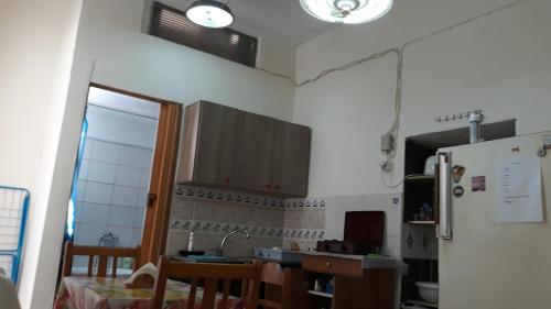 A kitchen or kitchenette at Amilia HOME near the port Piraeus