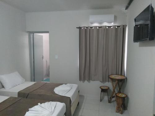 Cama ou camas em um quarto em Pousada Ondas da Fé