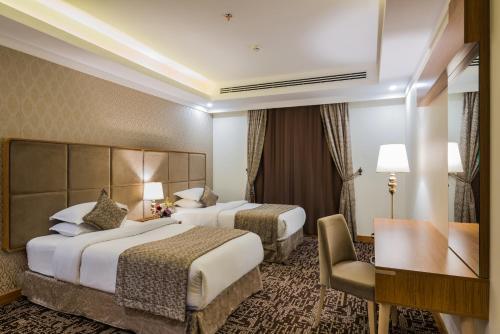 Cama ou camas em um quarto em Le Park Concord Hotel