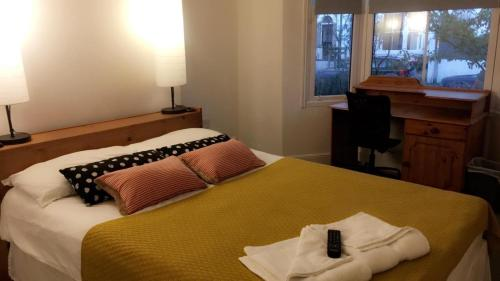 A bed or beds in a room at Golden Triangle