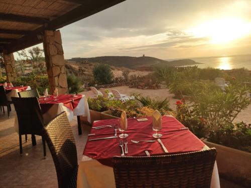 A restaurant or other place to eat at Hotel Villaggio Sabbie D'Oro