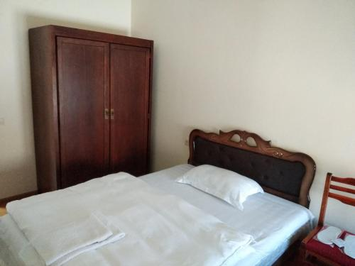 A bed or beds in a room at DownTown B&B
