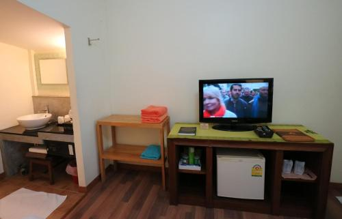 A television and/or entertainment center at Palita Lodge - SHA Plus