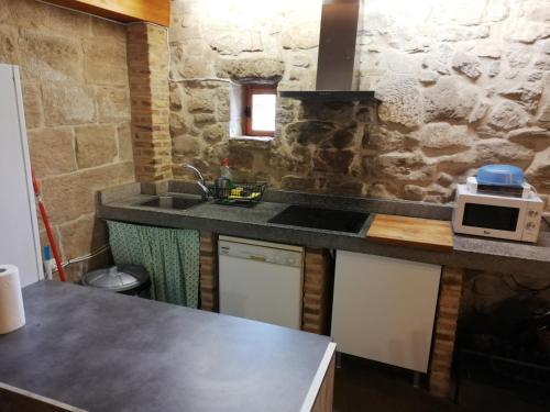 A kitchen or kitchenette at Casón Salto de Roldán
