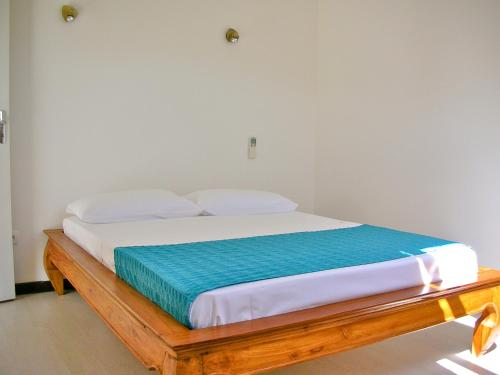 A bed or beds in a room at Hotel Cap Sud