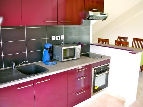 A kitchen or kitchenette at Hotel Cap Sud