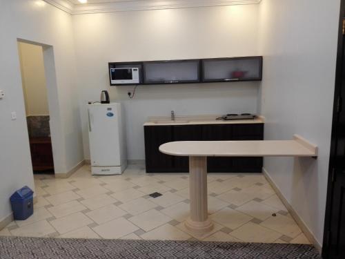 A cozinha ou cozinha compacta de Lotus Furnished Apartments