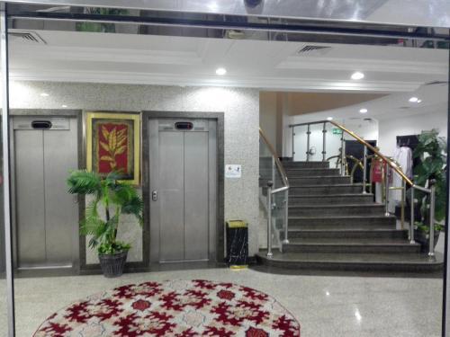 O saguão ou recepção de Lotus Furnished Apartments