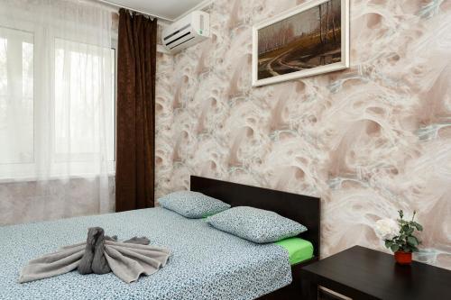 Кровать или кровати в номере BestFlat24 Apartament on VDNH
