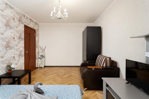 Телевизор и/или развлекательный центр в BestFlat24 Apartament on VDNH