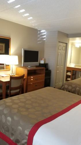 A bed or beds in a room at Ramada by Wyndham Pueblo