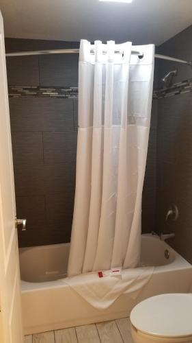 A bathroom at Ramada by Wyndham Pueblo