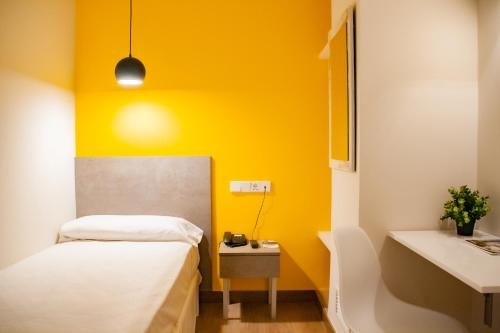 A bed or beds in a room at Hotel Universal Murcia