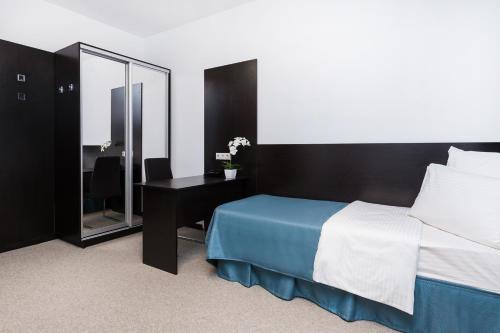 Кровать или кровати в номере Отель Силуэт
