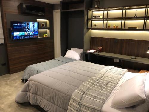 A bed or beds in a room at Apartamento super bem decorado em frente ao shopping