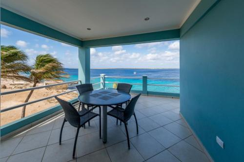 A balcony or terrace at Oceanfront Apartment Dolphin at Den Laman