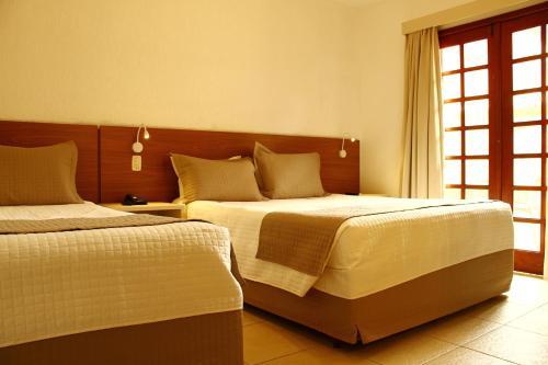 Cama ou camas em um quarto em Beach Hotel Cambury