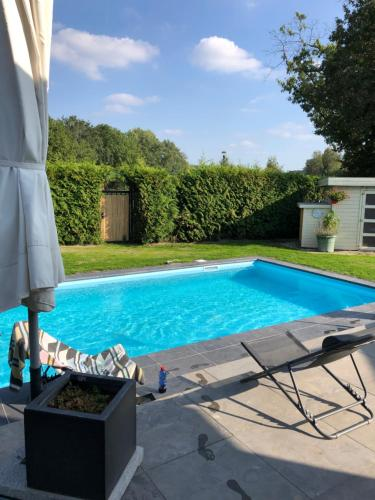 The swimming pool at or near B&B Maison Saint Tropez Eindhoven