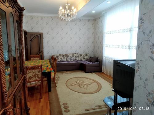 Uma área de estar em Guest House