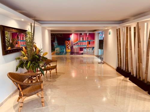 The lobby or reception area at Hotel Dann Cali