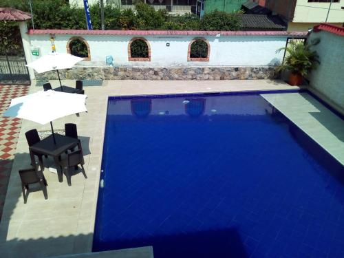 A view of the pool at Casa de Huespedes Villa Hermosa or nearby