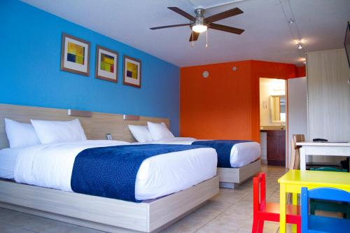 A bed or beds in a room at Flamingo Waterpark Resort