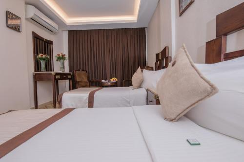 A bed or beds in a room at Andalus Hotel